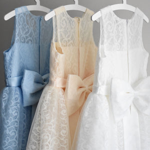 Three high quality girl dresses in blue cream and white colors with a big bow on the back