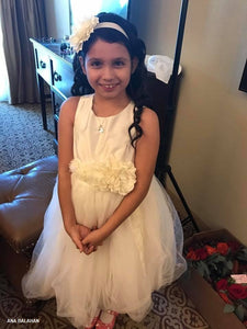 Flower girl wearing ivory Camellia set of wedding accessories floral sash and headpiece