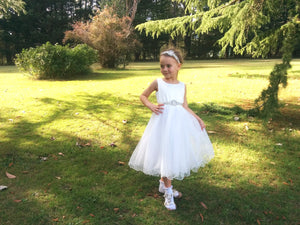 Girl in Adelina flower girl dress with rhinestone applique sash and headpiece set