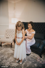 Load image into Gallery viewer, Beautiful flower girl in Roselle lace flower girl dress with open V-neck on the back and her mom