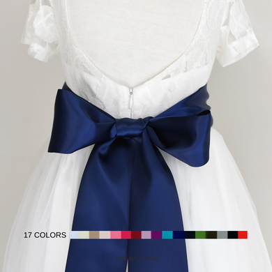 Off white color flower girl dress with the 8 cm navy color satin sash back view