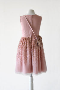 Ninel Finery girl clothing in pink blush color with pink gold seqiuns with cross bag back view
