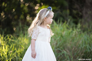 Girl in champagne lace flower girl dress