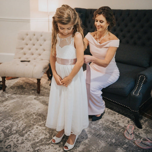 Roselle Teen flower girl in long lace and chiffon dress with her mum Ana Balahan