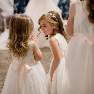 Two pretty girls in Adelina ivory color dressesAna-Balahan