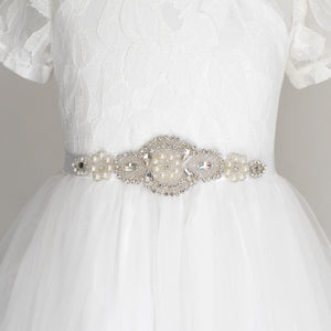 White color sash with gems and crystals with off white color dress