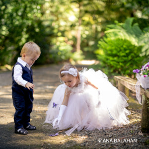 Cute little girl in white tutu dress and a boy in a gentleman suit