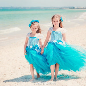 Two girls in Breeze dress on a beach