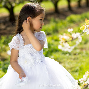 Beautiful girl in white Jasmine blossom tutu dress