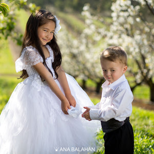 Girl in white Jasmine blossom tutu dress and handsome boy in smart suit