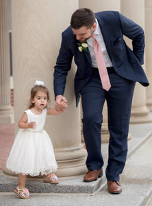 Bride walks with his daughter wearing comfortable Adelina dress