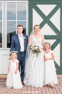 Bride and groom with two girls in Annabelle dress