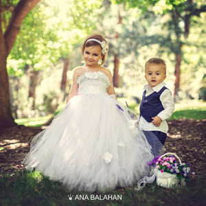 Boy in a fashionable cotton suit and a flower girl wearing tutu dress