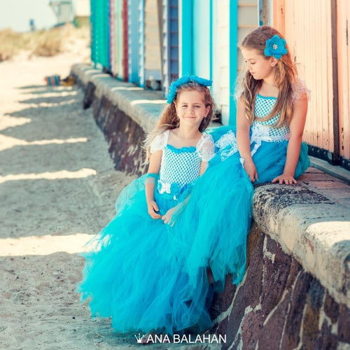 Two girls in Breeze dress near beach houses