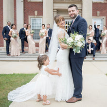 Load image into Gallery viewer, Bride and groom together with a flower girl dress in Adelina ivory dress