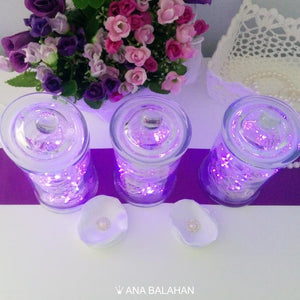 Sparkling LED lights in jars top view