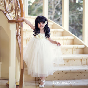 Girl in Annabelle dress on stairs