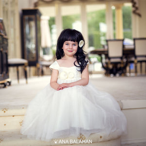Girl in Annabelle dress sitting on steps