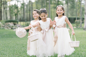 Flower girls in Ana Balahan dresses wearing high quality satin sashes