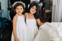 Load image into Gallery viewer, Two pretty girls in Florence dress and floral wreath prepare to be flower girls at a wedding