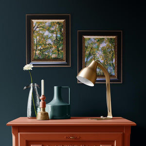 interior design 2 framed Fall forest nature paintings on teal wall with gold lamp by Aimee Schreiber