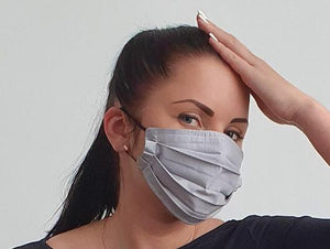 woman with cotton handmade reusable face mask face covering gray
