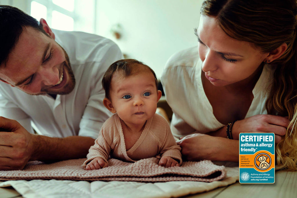 happy parents and baby with pure zees baby mattress