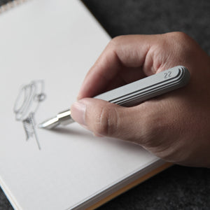 Man Drawing A Watch With A Concrete Fountain Pen