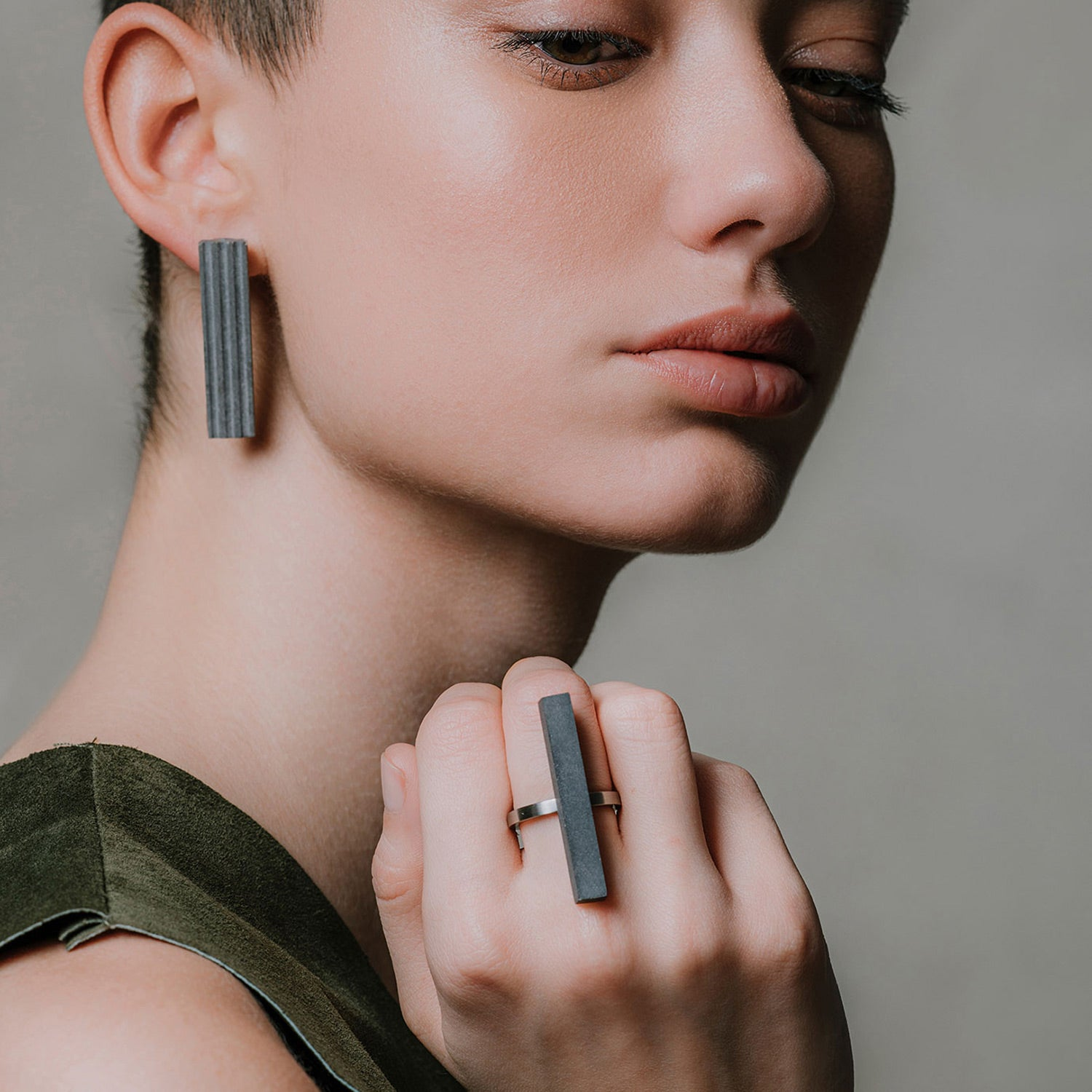 Female Model Wearing Minimal Concrete Jewelry