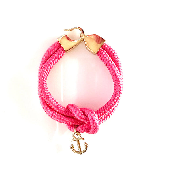 Hot pink cotton rope sailor bracelet with gold anchor charm, hook and loop closure