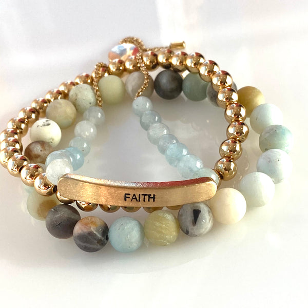 FAITH charm slider in pplished blue stones, with an 8MM blue/green beaded stretch and  a petite gold beaded stretch