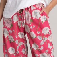 Closeup of dark pink Dahlia PJ Pants with white flowers and greenery