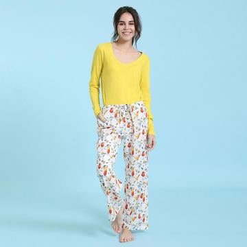 Model wearing Cocktail PJ Pants with a yellow shirt