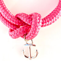 Close up of the Silver anchor charm on hot pink sailor knot bracelet