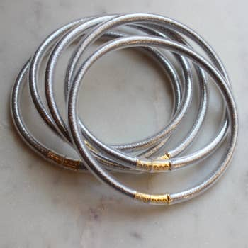 5 piece set of silver metallic tube bangles