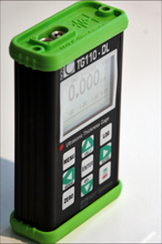Load image into Gallery viewer, Nova TG110-DL General Purpose Ultrasonic Thickness Gauge in aluminium casing with green rubber end caps for additional protection - Advanced NDT Limited