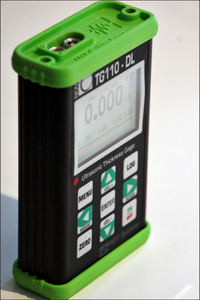 Nova TG110-DL General Purpose Ultrasonic Thickness Gauge in aluminium casing with green rubber end caps for additional protection - Advanced NDT Limited
