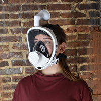 Emily models the Narwall Mask in black.