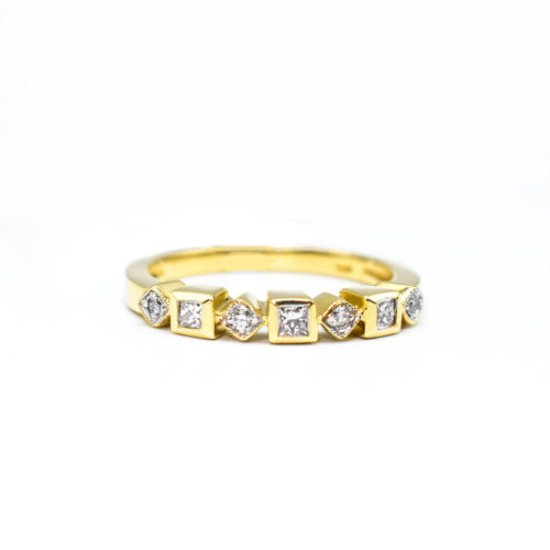 14K Gold Wedding Band with 0.18ct of Diamonds