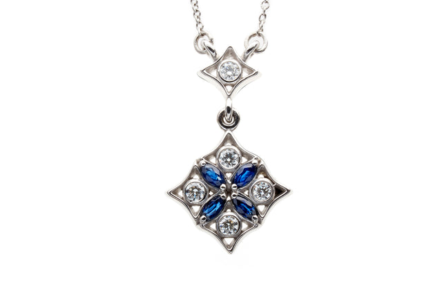Night falls over graceful parterres. Diamonds glisten like dew forming on moonlit leaves and deep blue marquise sapphires articulate the gentle curves of geometric design.