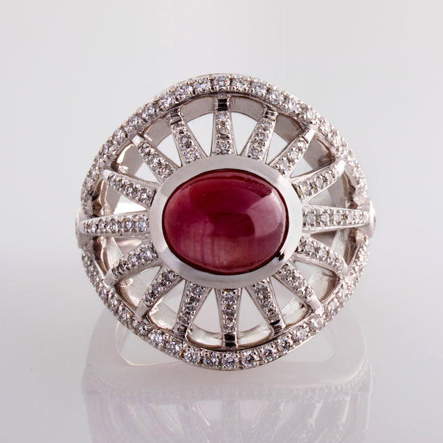 In spectacular Art Deco inspired style Sprazzo di Sole's sunburst rays, adorned with diamonds, flaring from stunning star rubies. Jewellery designed by Biagio Patalano
