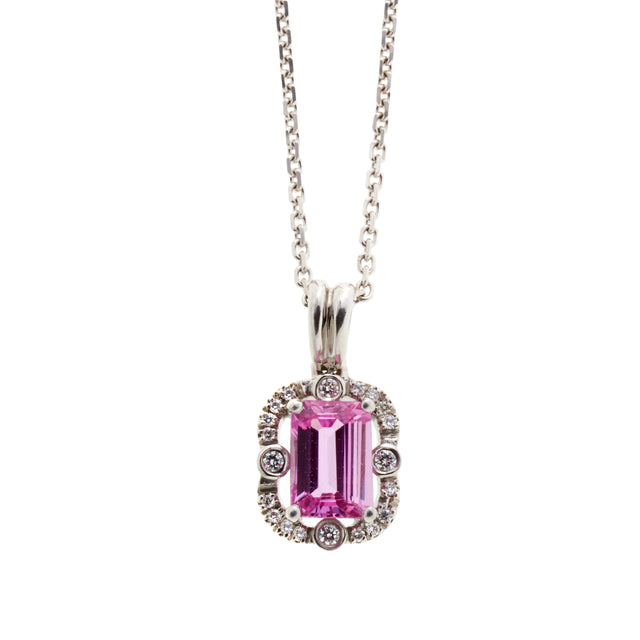 Emerald cut octagon pink sapphire necklace surrounded by round cut brilliant diamonds. Part of the Ballerina collection.