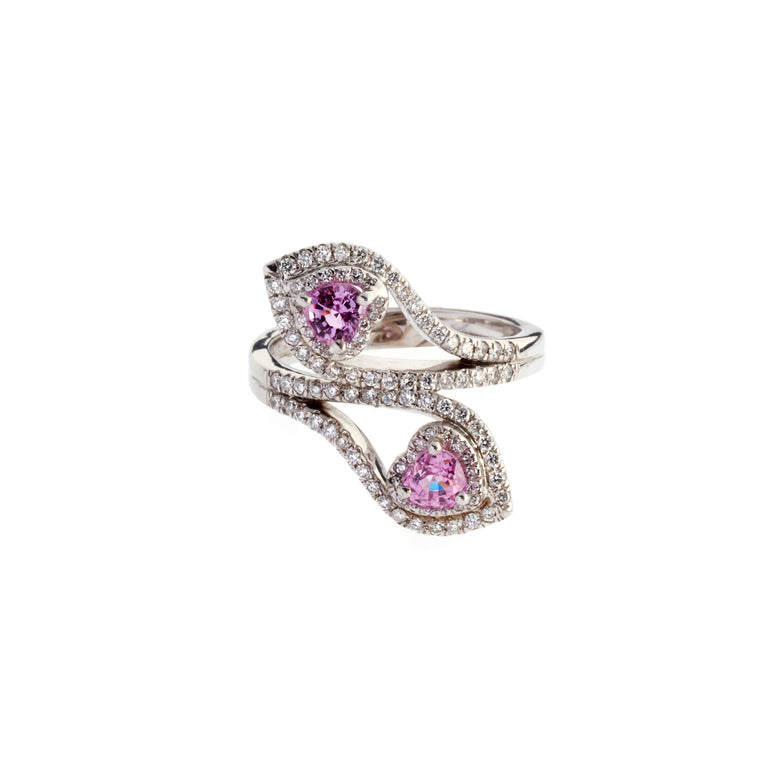 A pair of ruby hearts set in white gold, surrounded by round brilliant diamonds. Designed by Biagio Patalano.
