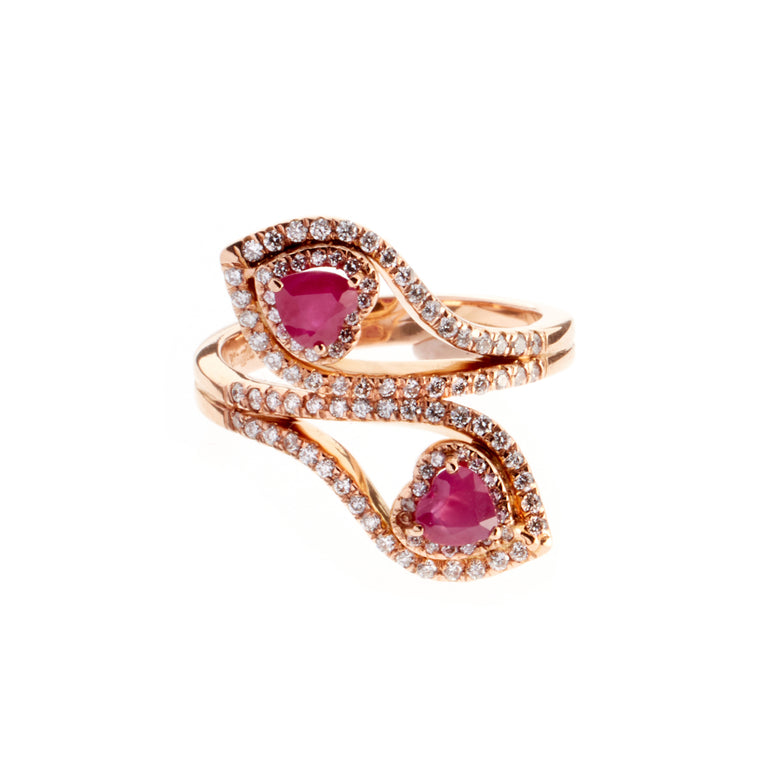 A pair of ruby hearts set in rose gold, surrounded by round brilliant diamonds. Designed by Biagio Patalano.