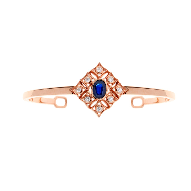 Oval sapphire and diamond 18ct rose gold bangle. Part of the Rinascimento Notta Rosa collection.