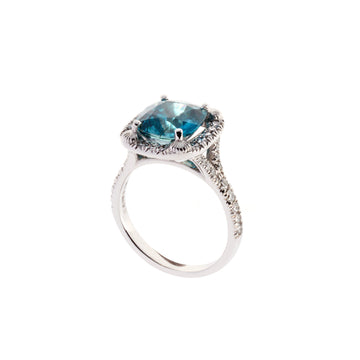 Blue zircon halo ring surrounded by round brilliant diamonds. Designed by Biagio Patalano