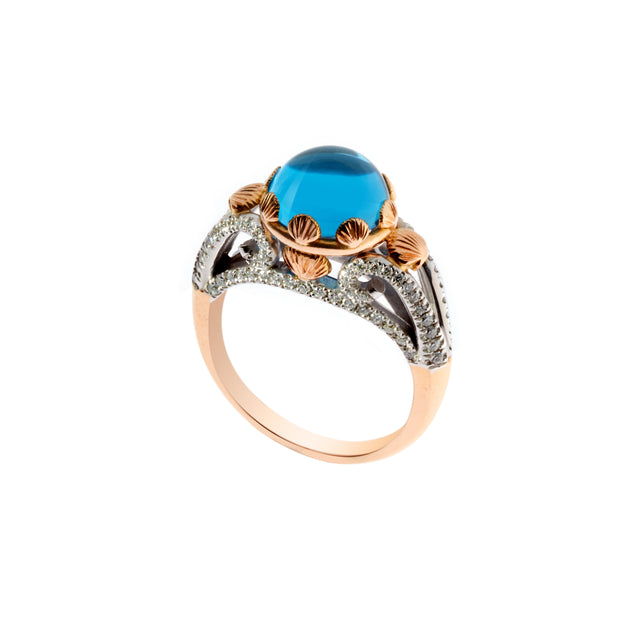 Blue topaz cabochon set in 18ct white & rose gold with round brilliant diamonds. Designed by Biagio Patalano.