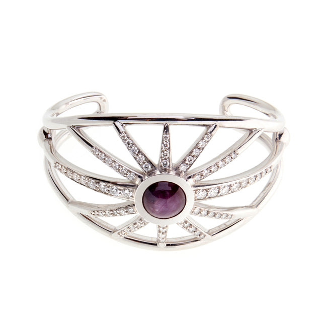 A round cabochon star ruby cuff with diamond studding spokes designed by Biagio Patalano.