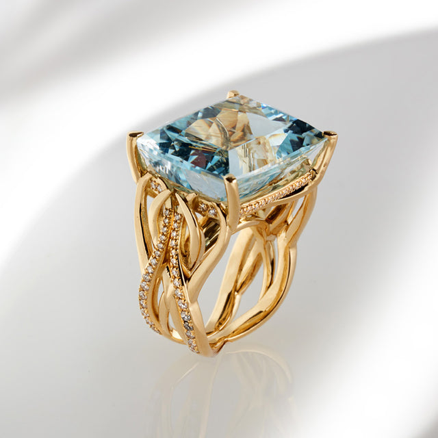 cushion cut topaz set in 18ct yellow gold with round brilliant cut diamonds designed by Biagio Patalano