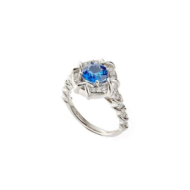 Round sapphire with round brilliant diamonds set in platinum. Designed by Biagio Patalano.
